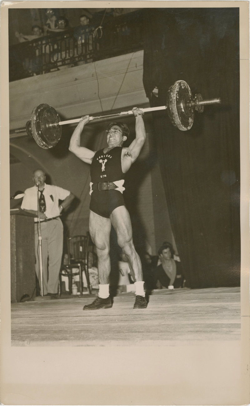 Photo of Tommy Kono performing a clean and jerk lift