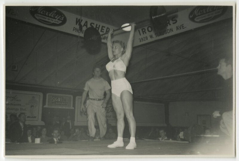 Pudgy lifting barbell at competition