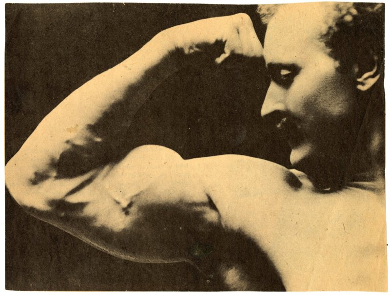 Sandow flexing right biceps, detail