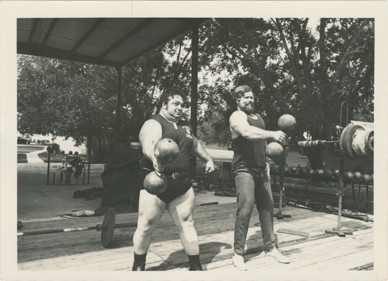 Photo of Paul Anderson and Terry Todd lifting dumbells