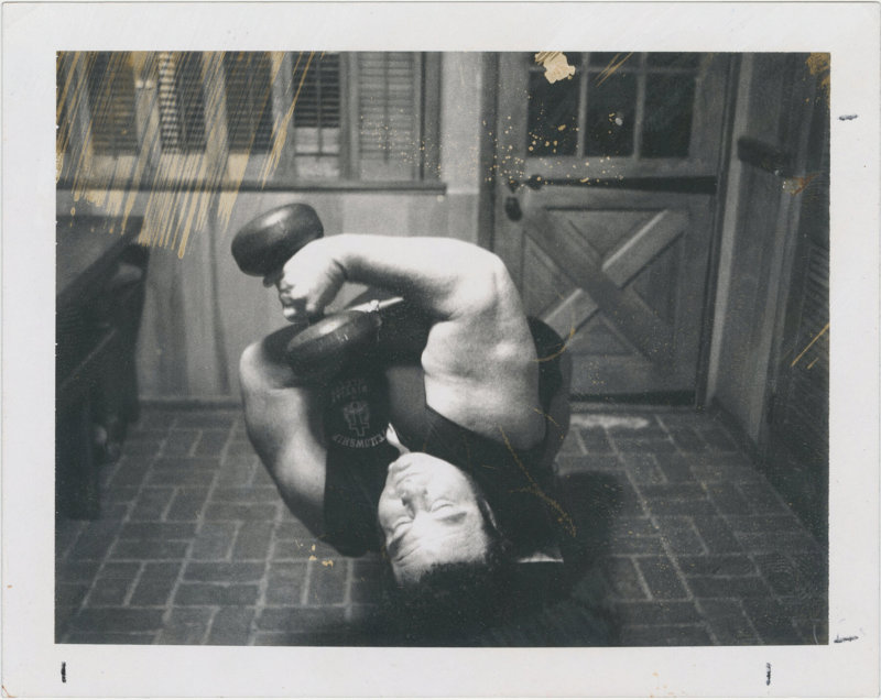 Photo of Paul Anderson lifting a dumbell
