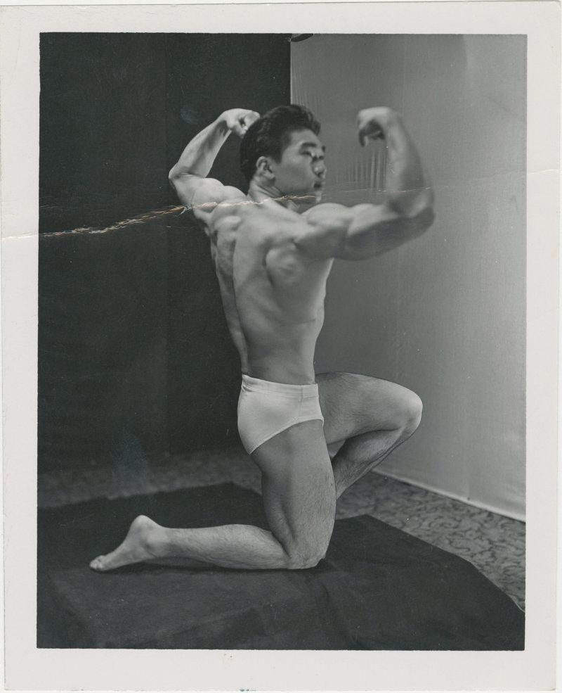 Photo of Tommy Kono posing in a kneeling position
