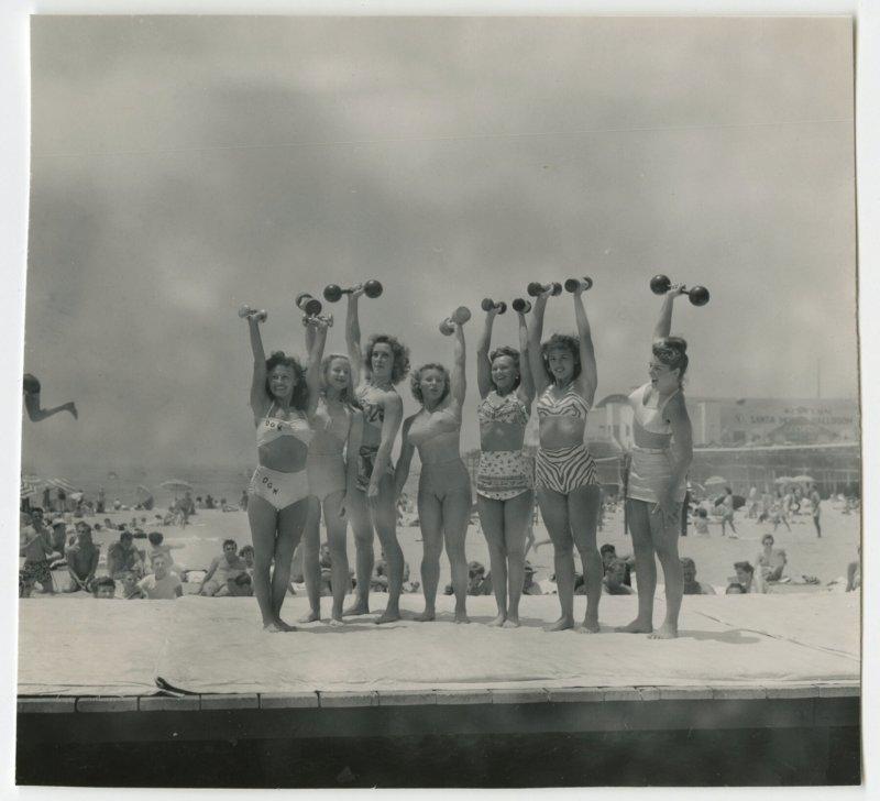 Group of women lifting dumbbells on platform