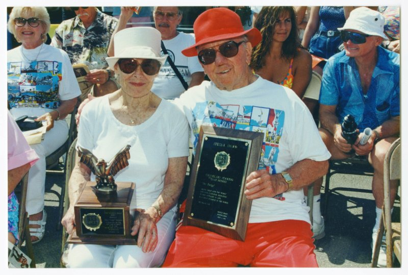 Pudgy and Les holding their awards