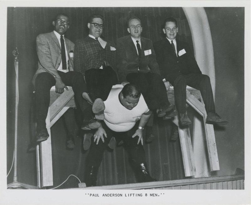 Paul Anderson lifting 8 men