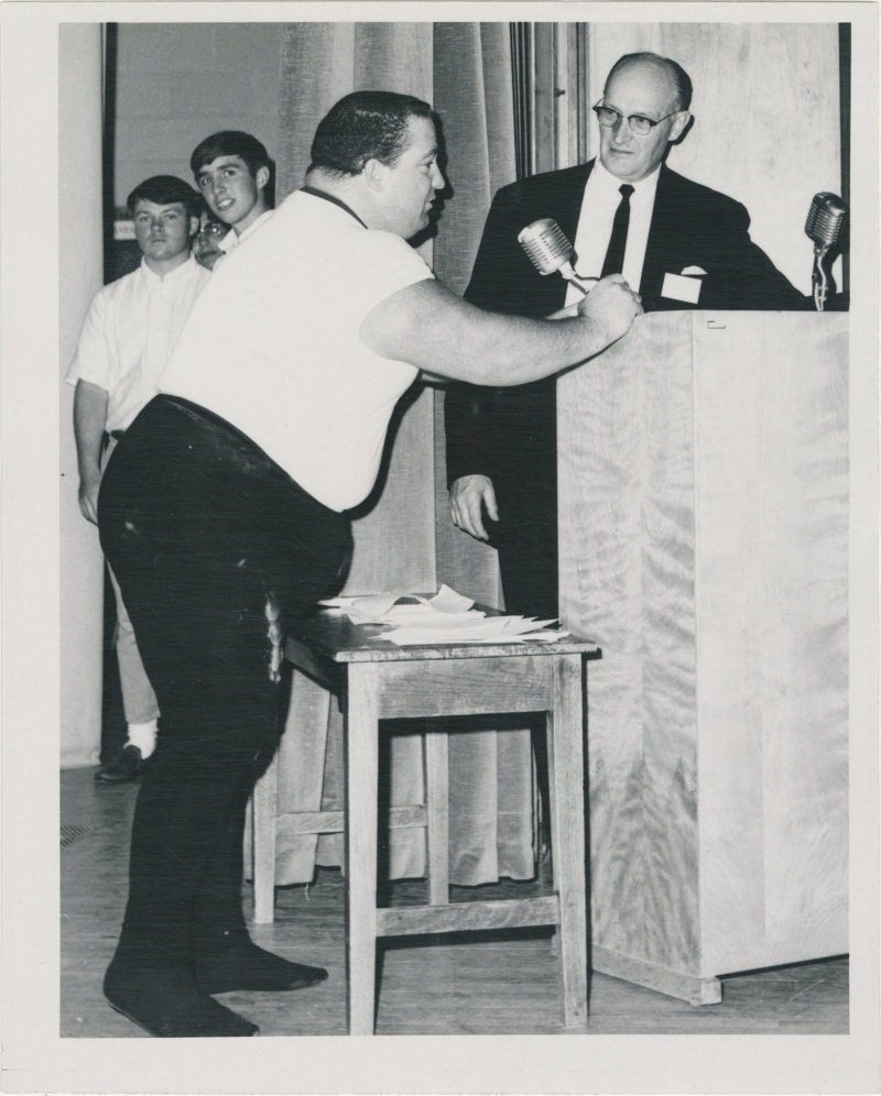 Photo of Paul Anderson speaking into a microphone
