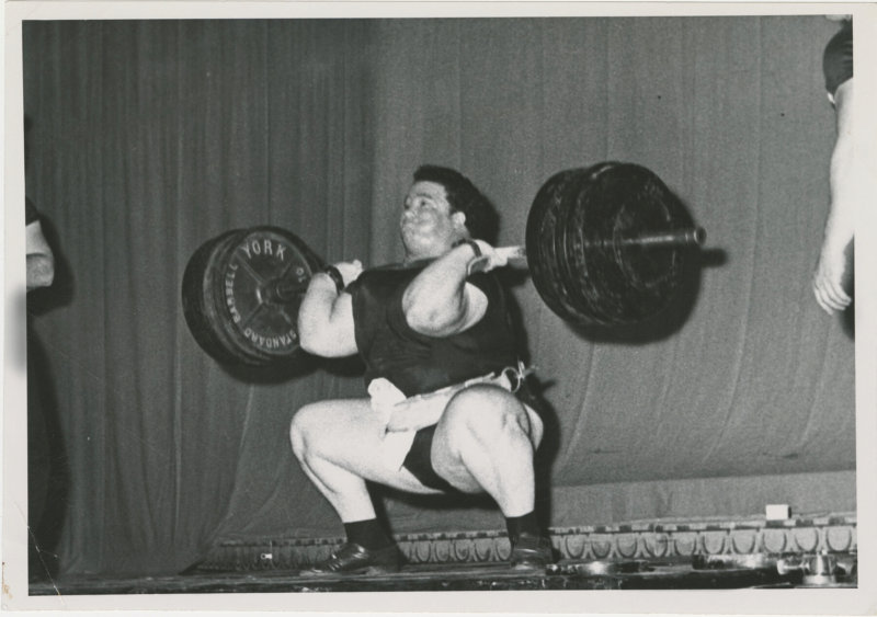 Photo of Paul Anderson completing a lift at a competition